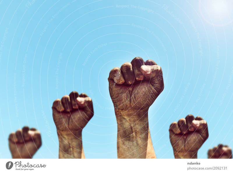 Male hands are clenched into a fist Freedom Sun Human being Man Adults Hand Fingers Group Sky Old Aggression Dirty Retro Strong Blue Black Power Might