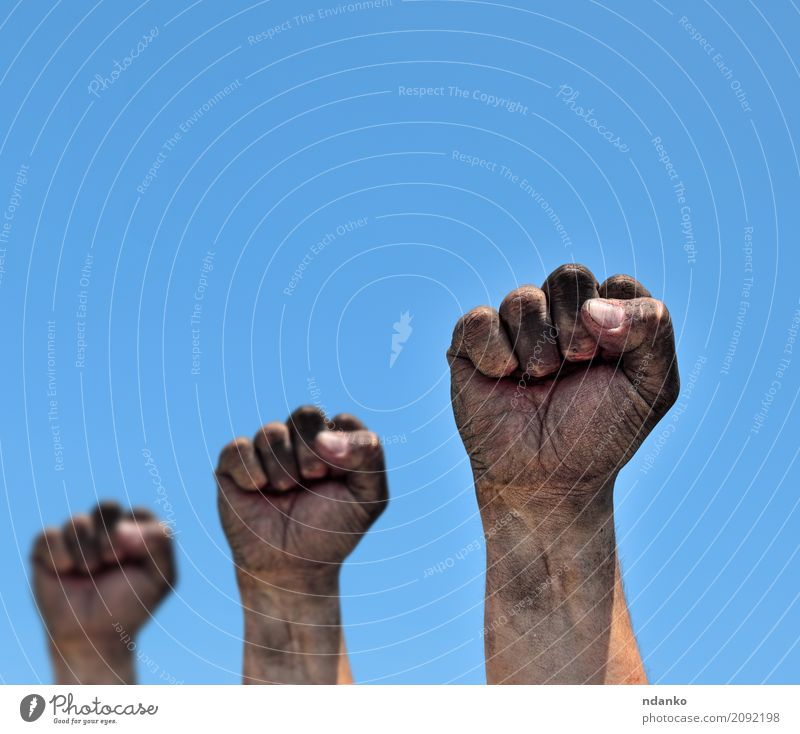 Three dirty male fists raised up Freedom Man Adults Hand Fingers Sky Old Aggression Dirty Strong Blue Black Optimism Power Protection Might Age aggressive