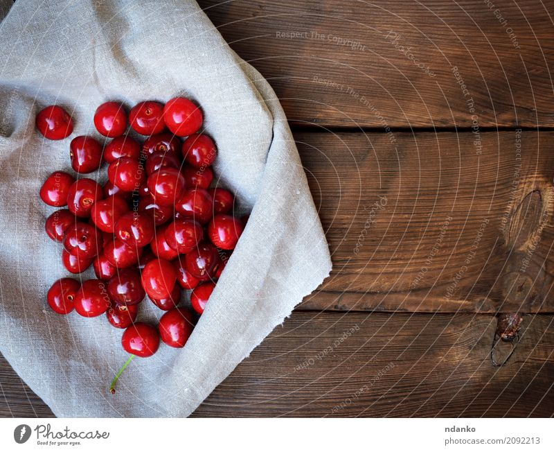 Ripe sweet cherry on a gray tablecloth Fruit Dessert Eating Vegetarian diet Juice Summer Garden Table Nature Wood Fresh Natural Above Retro Juicy Red ripe many