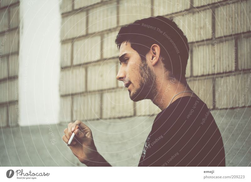 Youth (Young adults) Face Loneliness Wall (building) Hair and hairstyles Head Stone Adults Masculine Facade Lifestyle Cool (slang) Smoking Uniqueness Cigarette