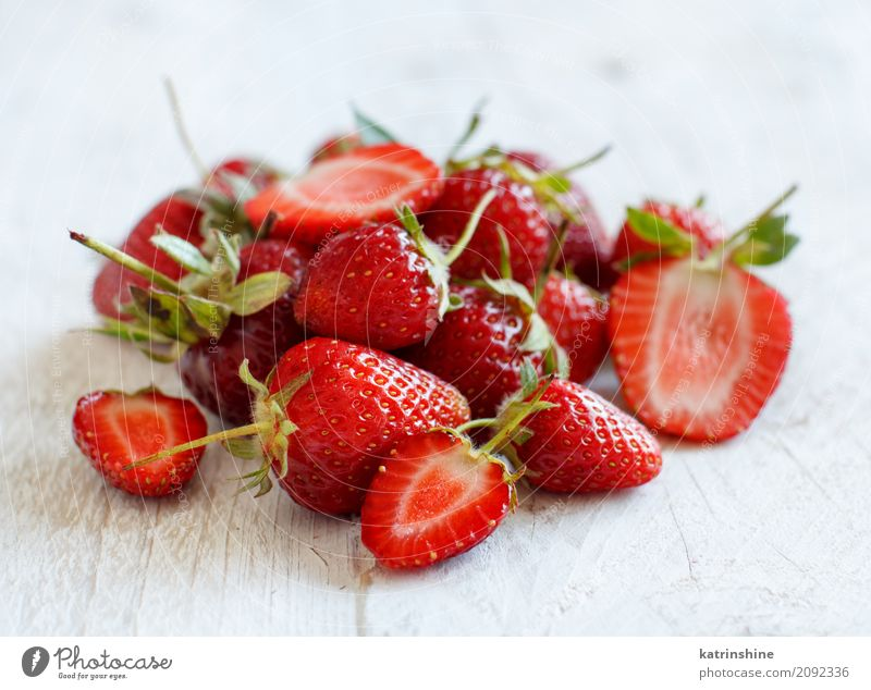Strawberries close up on a white wooden table Fruit Dessert Diet Summer Table Wood Fresh Bright Delicious Natural Juicy Red White Colour Berries colorful Edible