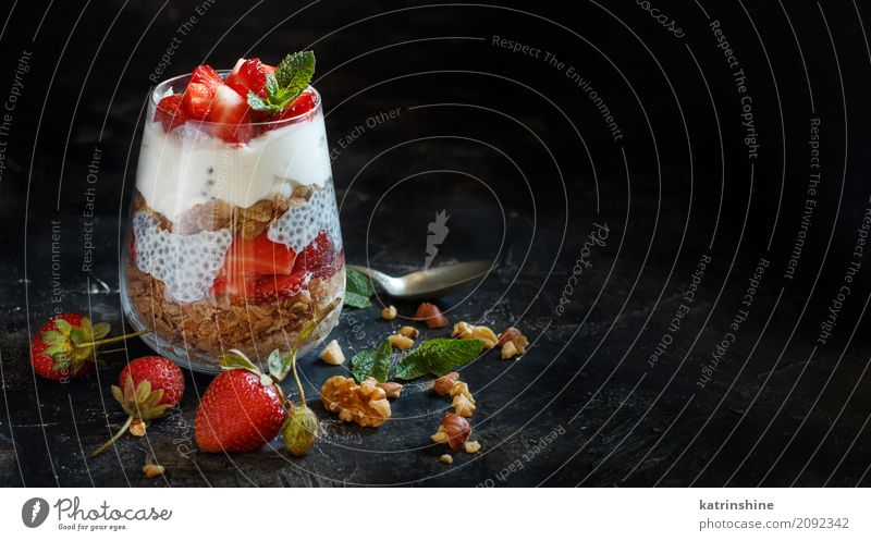 Chia pudding Strawberry parfait with greek yogurt and nuts Yoghurt Fruit Dessert Breakfast Diet Glass Spoon Dark Red White Berries Cereal chia Pudding seed