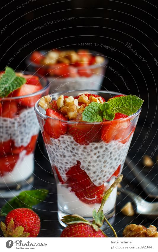 Chia pudding Strawberry parfait with greek yogurt and nuts Yoghurt Fruit Dessert Breakfast Diet Glass Spoon Red White Berries Cereal chia Pudding seed Dairy