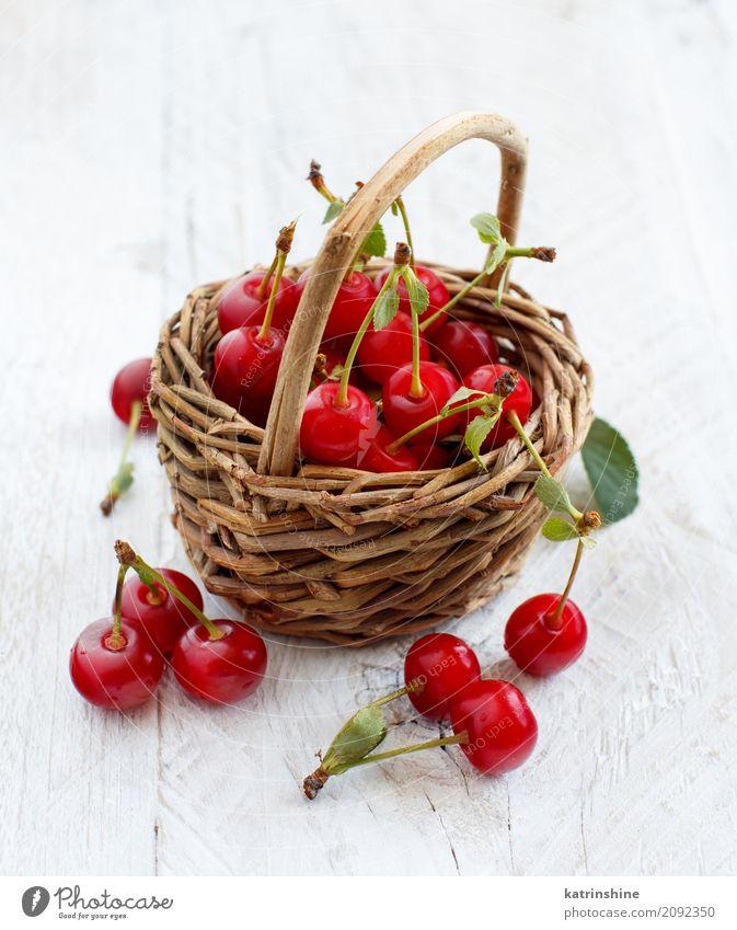 Fresh sour cherries ina basket on a wooden table Fruit Vegetarian diet Diet Summer Table Leaf Dark Delicious Juicy Sour Wild Brown Green Red Berries Cherry food