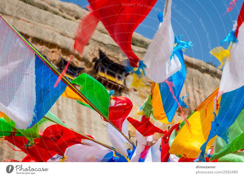 Mati Si temple with colorful praying flags, China Meditation Vacation & Travel Tourism Culture Rock Building Architecture Monument Flag Old Historic Red