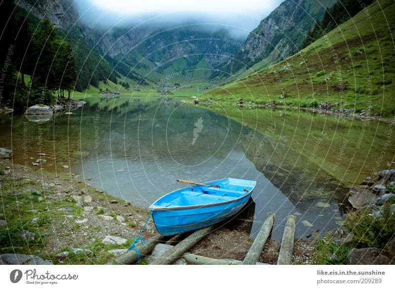 lonely mountain lake II Senses Relaxation Calm Summer vacation Mountain Nature Clouds Bushes Hill To enjoy Power Reflection Watercraft Rowboat Blue Lake