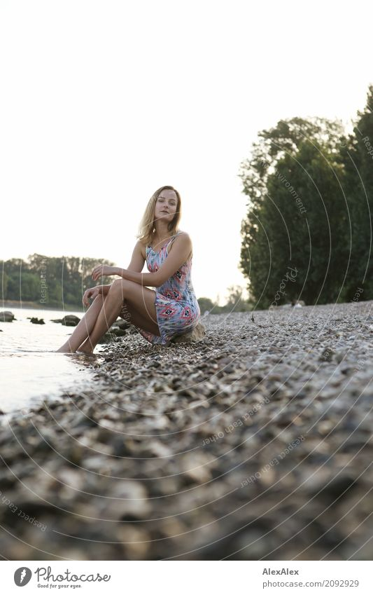 Young woman in summer dress sitting on the banks of the Rhine with her feet in the river Wellness Relaxation Trip Summer Summer vacation Youth (Young adults)