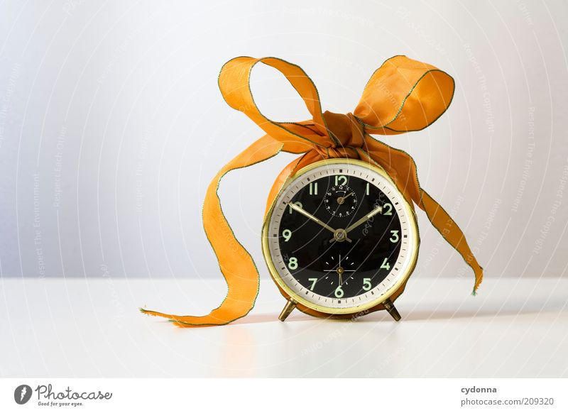 Time wasted Lifestyle Design Beginning Accuracy Idea Creativity Planning Bow Gift Gift wrapping Private Clock face Alarm clock Colour photo Interior shot