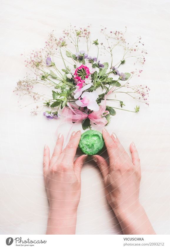 Female hands hold handmade green soap Style Beautiful Personal hygiene Cosmetics Healthy Spa Feminine Woman Adults Hand Plant Flower Design Aromatic Self-made