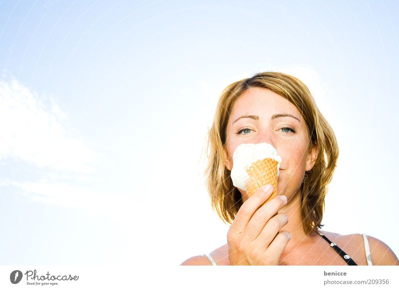 Woman Human being Youth (Young adults) Sky Summer Nutrition Ice Eating Ice cream Delicious Appetite Candy Refreshment Dessert Action Portrait photograph