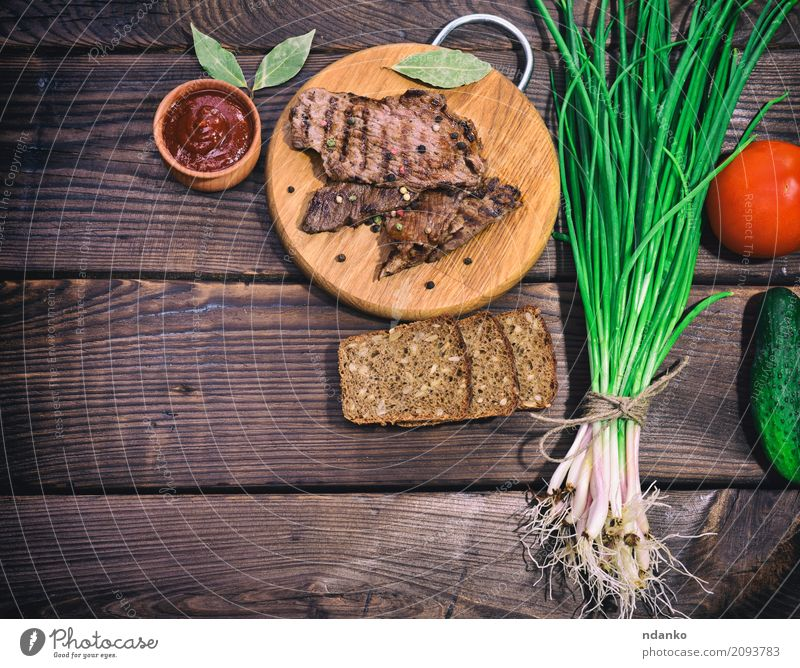 Fried veal grilled with spices Green Red Dish Wood Above Nutrition Fresh Table Herbs and spices Kitchen Vegetable Bread Meat Dinner Meal Top