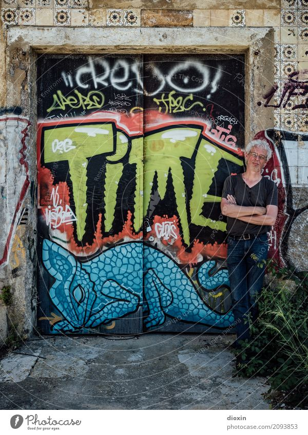 Human being Man Adults Wall (building) Graffiti Wall (barrier) Art Time Masculine 45 - 60 years Stand Painting and drawing (object) Gate Work of art Street art