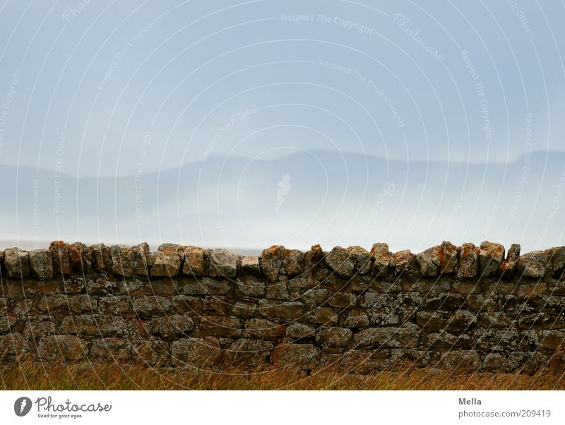 Nature Sky Blue Calm Loneliness Wall (building) Emotions Mountain Stone Wall (barrier) Landscape Air Moody Fog Environment Rock