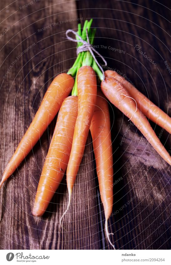 Fresh carrots Vegetable Nutrition Eating Vegetarian diet Diet Table Nature Plant Leaf Wood Natural Green ripe Useful agriculture iron Organic orange Salad Tasty