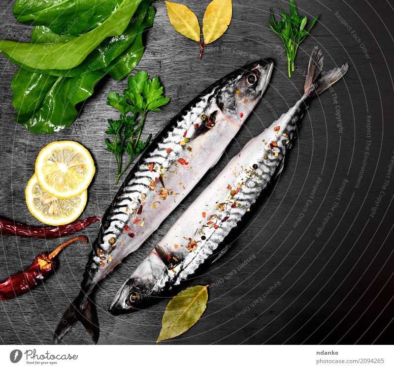 Two fresh mackerel in spices Nature Naked Green Ocean Animal Dark Black Natural Wood Nutrition Fresh Table Herbs and spices Gastronomy Restaurant Dinner