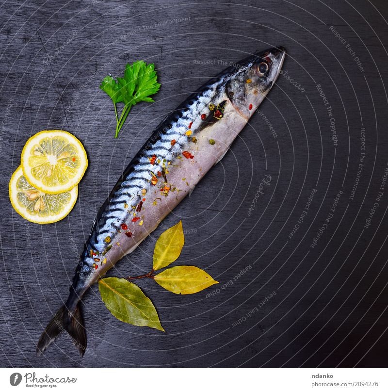 Whole fresh mackerel with spices Seafood Herbs and spices Table Gastronomy Animal Wood Dark Fresh Naked Natural Green Black Mackerel Meal Top cook background