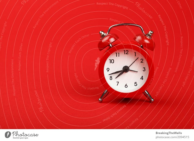 Retro alarm clock with bells over red paper background close up Clock Tool Technology Paper Metal Digits and numbers Old Running Movement Sleep Wait Hot