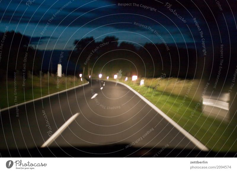 high beam Evening Car Highway Driving Vacation & Travel Movement Line Direct journey home Curve Country road Night Reflector Reflection Travel photography Speed