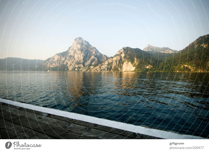 evening Environment Nature Landscape Water Sky Cloudless sky Sunlight Summer Beautiful weather Hill Mountain Peak Lakeside Footbridge Traunsee Salzkammergut