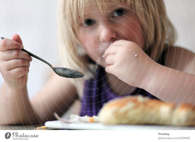 Child Hand Calm Girl Face Life Hair and hairstyles Eating Head Food Blonde Infancy Skin Mouth Nutrition Discover