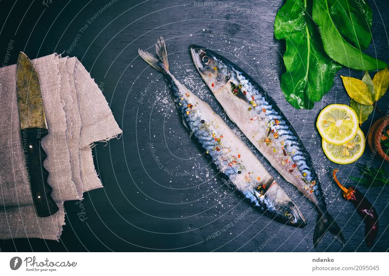 Two mackerels in spices Seafood Herbs and spices Nutrition Lunch Dinner Diet Knives Ocean Table Kitchen Restaurant Gastronomy Animal Wood Dark Fresh Natural