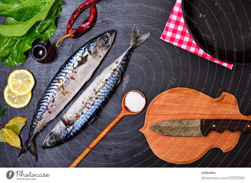 Fresh mackerel fish with spice Seafood Herbs and spices Nutrition Lunch Dinner Diet Pan Spoon Ocean Table Restaurant Gastronomy Nature Animal Wood Natural Green