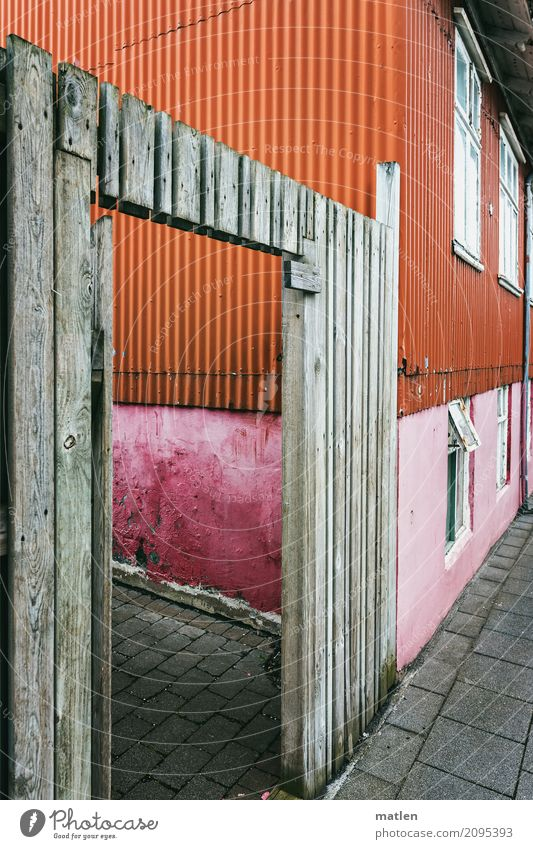 Reykjavik Town Capital city Port City Downtown Deserted Detached house Wall (barrier) Wall (building) Facade Window Door Street Old Gray Orange Pink