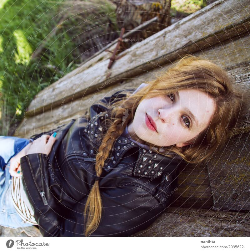 Young modern woman lying on a old wood door Lifestyle Style Hair and hairstyles Wellness Well-being Relaxation Human being Feminine Young man