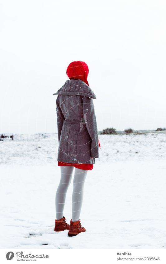 Back view of a woman waiting for something in a snowy day Elegant Style Adventure Freedom Winter Snow Human being Feminine Young woman Youth (Young adults) 1