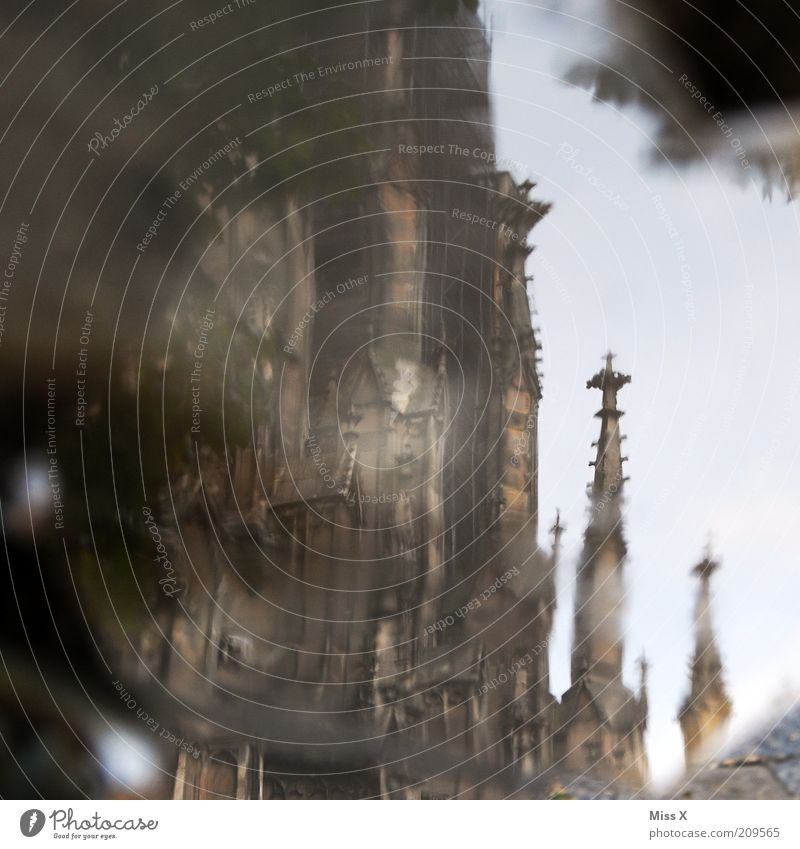 Ulm Cathedral Tourism Sightseeing City trip Church Dome Tourist Attraction Landmark Wet Tower Gothic period Puddle Water Colour photo Exterior shot Experimental