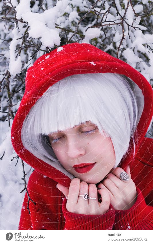 Portrait of a young woman wearing a hooded sweater Human being Youth (Young adults) Young woman Beautiful White Red Relaxation Calm Winter 18 - 30 years Adults
