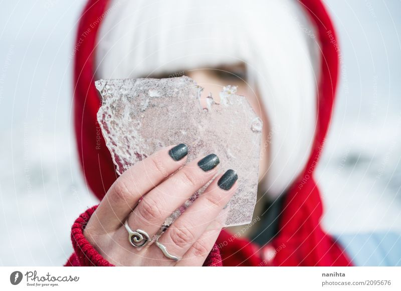 Young woman holding a piece of ice Human being Nature Youth (Young adults) White Young man Hand Red Winter 18 - 30 years Adults Cold Natural Feminine