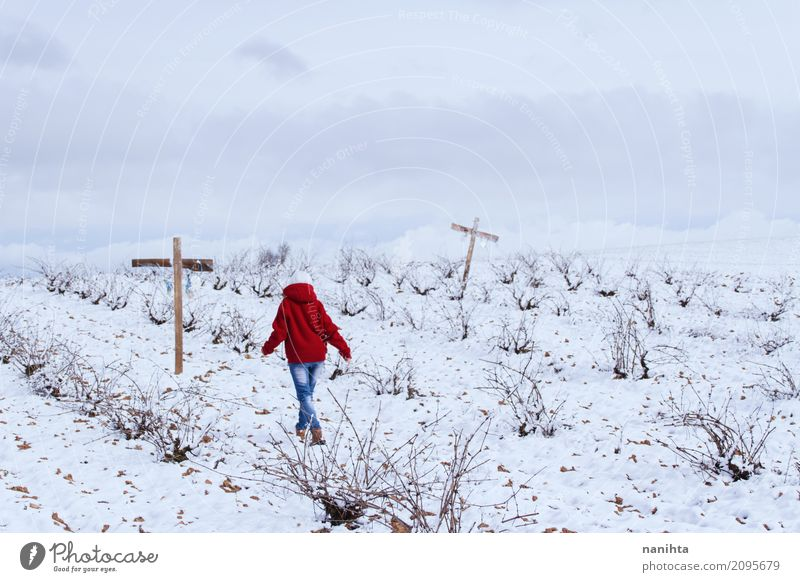 Someone walking in a snowy field with crosses Human being Androgynous Youth (Young adults) 1 18 - 30 years Adults Environment Nature Landscape Sky Clouds Winter