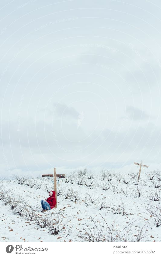 Young person alone in a snowy graveyard Human being Feminine Young woman Youth (Young adults) 1 18 - 30 years Adults Environment Nature Landscape Sky