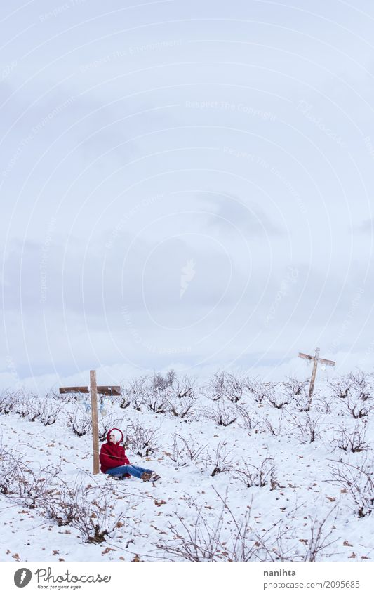 One person leaning on a cross in a snowy field Human being Feminine Young woman Youth (Young adults) 1 18 - 30 years Adults Environment Nature Landscape Sky