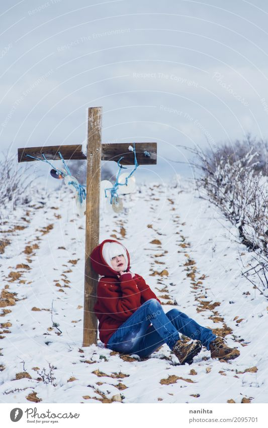 Young woman near a cross in a winter day Style Design Human being Feminine Youth (Young adults) 1 18 - 30 years Adults Environment Nature Plant Winter Climate
