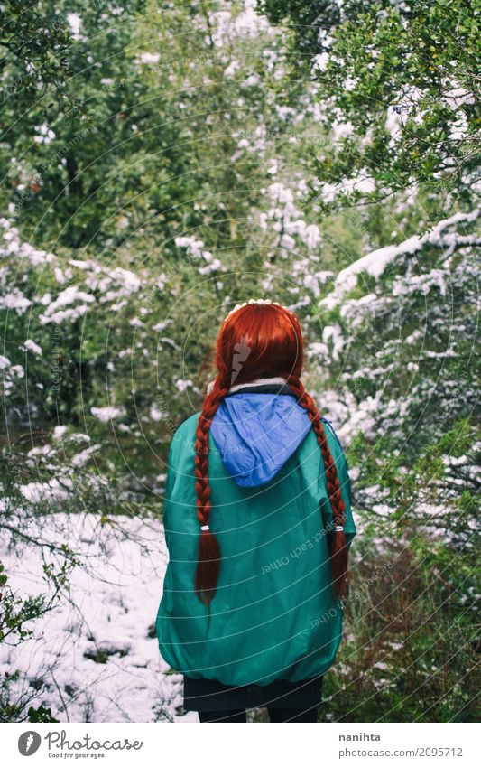 Back view of a redhead woman lost in a forest Human being Nature Vacation & Travel Youth (Young adults) Young woman Green Red Loneliness Winter Forest