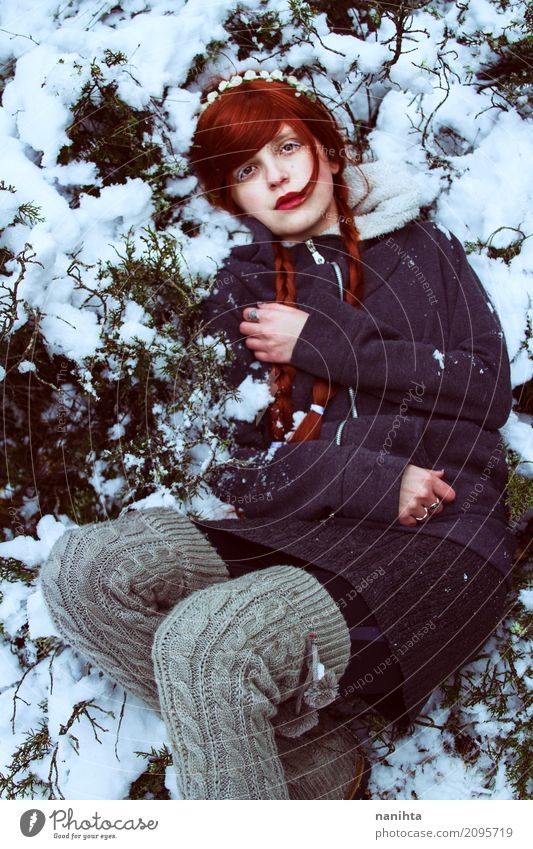 Young redhead woman lying on snow Human being Nature Youth (Young adults) Plant Young woman Beautiful White Red Loneliness Winter 18 - 30 years Adults Cold