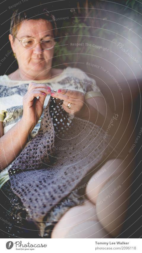 Grandma crocheting a pillow cover in garden Design Relaxation Leisure and hobbies Knit Work and employment Craft (trade) Woman Adults Grandmother Hand Optimism
