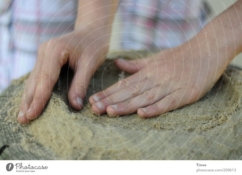 sand cake Leisure and hobbies Playing Infancy Hand Fingers Touch Movement Creativity Structures and shapes Sand Sand cake Round Diligent Colour photo