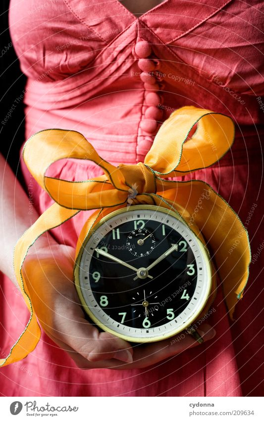 for you Lifestyle Contentment Human being Woman Adults Hand Accuracy Idea Planning Transience Time Alarm clock Clock Bow Gift Colour photo Close-up Detail Day