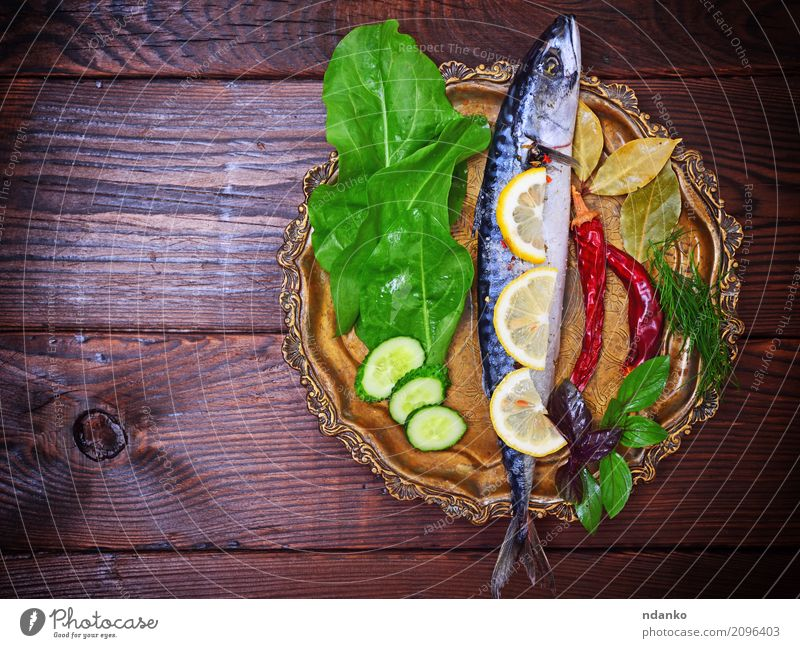 Mackerel with spices and herbs Seafood Herbs and spices Nutrition Eating Lunch Dinner Diet Plate Ocean Table Restaurant Gastronomy Nature Animal Wood Dark Fresh