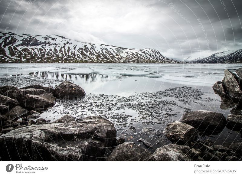 norge VI Nature Landscape Water Storm clouds Spring Winter Mountain Glacier Lake Norway Scandinavia Jotunheimen Dark Fluid Cold Wet Gloomy Brown Gray Turquoise