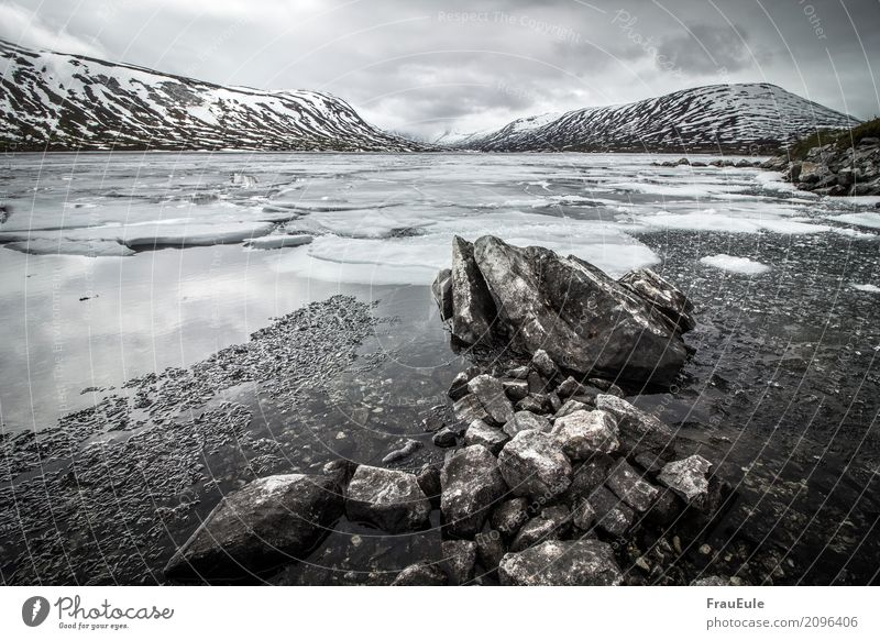 norge V Nature Landscape Water Storm clouds Spring Winter Mountain Glacier Lake Norway Scandinavia Jotunheimen Dark Gigantic Cold Brown Gray Snow Ice Ice floe