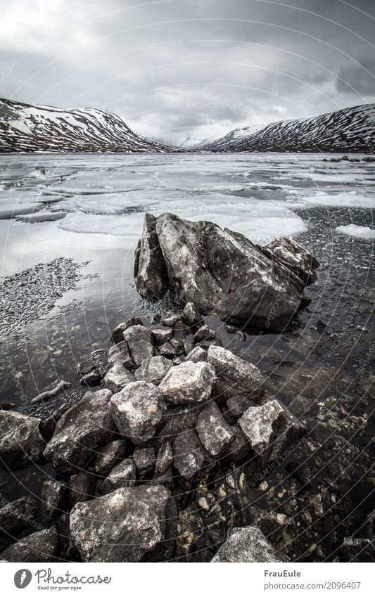norge IV Nature Landscape Water Storm clouds Spring Winter Mountain Glacier Lake Norway Scandinavia Jotunheimen Deserted Dark Fluid Cold Wet Brown Gray Ice