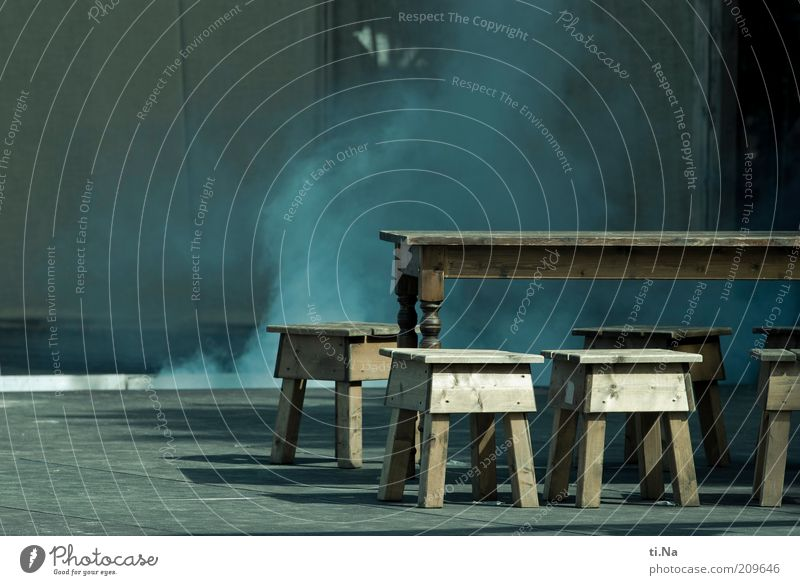 sound and smoke Art Stage play Smoke Blue Gray Table Chair Wooden table Wooden chair Asphalt Shadow Sunlight Medieval times Colour photo Subdued colour