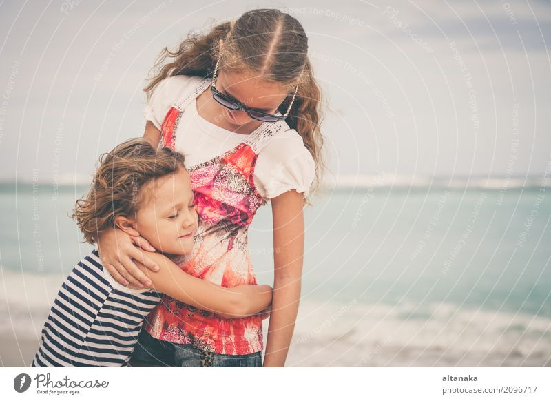 Sister and brother playing on the beach Lifestyle Joy Happy Beautiful Relaxation Leisure and hobbies Playing Vacation & Travel Freedom Summer Sun Beach Ocean