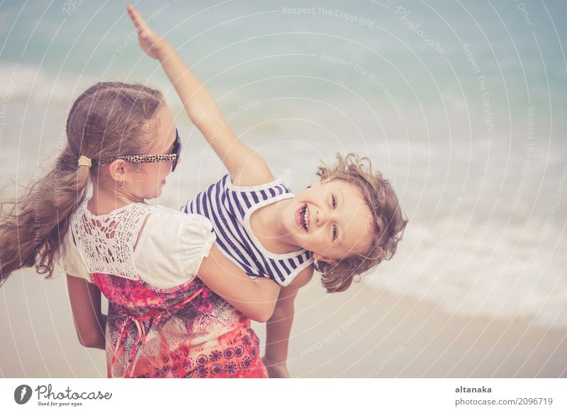 Sister and brother playing on the beach Human being Child Nature Vacation & Travel Summer Beautiful Sun Hand Ocean Relaxation Joy Beach Lifestyle Emotions