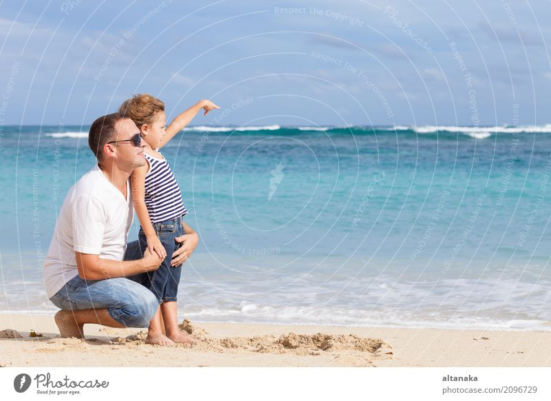 Happy father and son playing on the beach Lifestyle Joy Relaxation Leisure and hobbies Playing Vacation & Travel Trip Freedom Summer Sun Beach Ocean Child