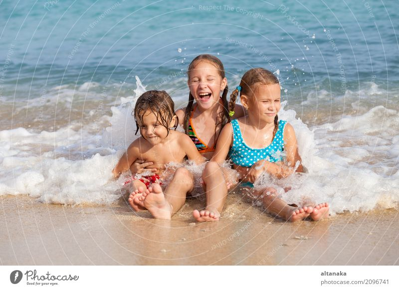 Two sisters and brother playing on the beach Human being Child Nature Vacation & Travel Summer Beautiful Sun Hand Ocean Relaxation Joy Beach Lifestyle Emotions
